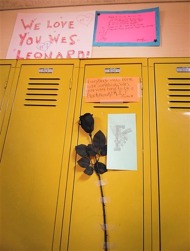 Notes and roses are left at Wes Leonard's locker by classmates.