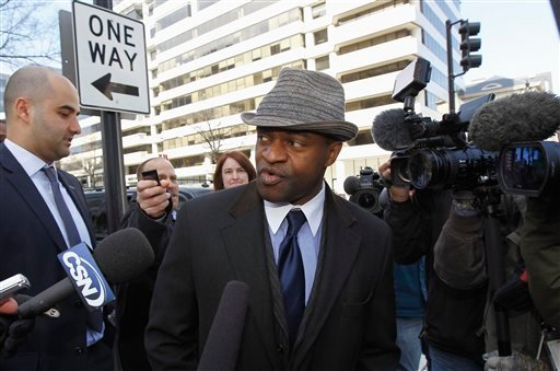NFLPA Executive Director DeMaurice Smith, center, accompanied by NFLPA spokesman with George Atallah, left, leave after football labor negotiations in Washington Friday, March 4, 2011.