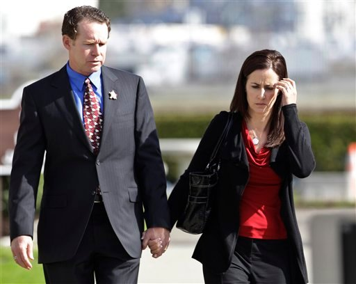 Alan and Caroline DeWeese, parents of Anthony DeWeese, walk to a Coast Guard court-martial in Alameda, Calif., Monday, March 7, 2011.