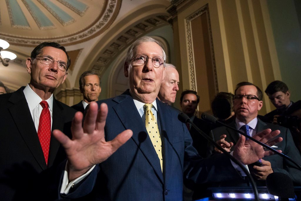 Senate Majority Leader Mitch McConnell, R-Ky., joined by, from left, Sen. John Barrasso, R-Wyo., Sen. John Thune, R-S.D., and Majority Whip John Cornyn, R-Texas, speaks following a closed-door strategy session, at the Capitol in Washington, Tuesday, June