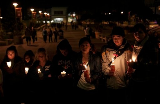 San Diego State University students hold candles during a vigil for missing student Austin Bice Monday, March 7, 2011.