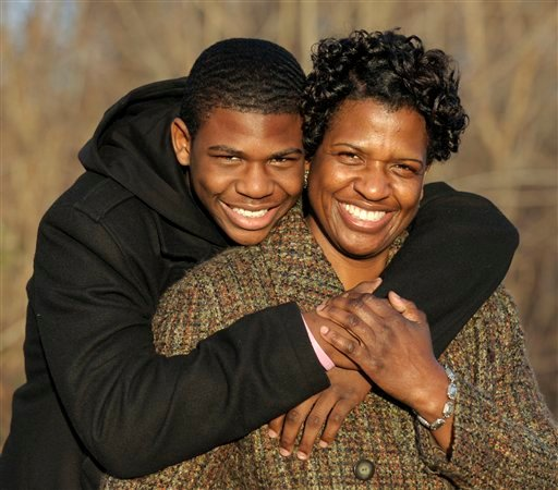 Staff Sgt. Robin Duncan-Chisolm gets a hug from her son Seth in Upper Marlboro, Md., on Monday, March 7, 2011. She was deployed to Iraq last year with the District of Columbia National Guard while she was getting a divorce. (AP Photo/Susan Walsh)