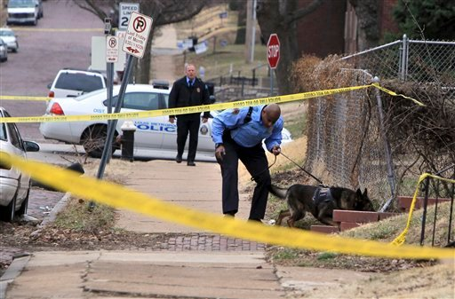 St. Louis police say two federal marshals and a police officer have been shot during a gunfight that left another man wounded at a home. (AP Photo/St. Louis Post-Dispatch, Christian Gooden)