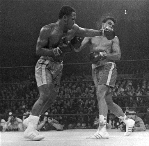 In this March 8, 1971, file photo, Muhammad Ali takes a left from Joe Frazier during the 15th round of their heavyweight title boxing bout in New York. Frazier won a unanimous decision.