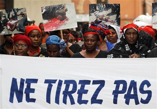Women carry a banner reading 'Don't shoot' as they participate in a march 'of mourning' for all the victims of post-election violence, in the Treichville neighborhood of Abidjan, Ivory Coast March 8, 2011. (AP Photo/Rebecca Blackwell)