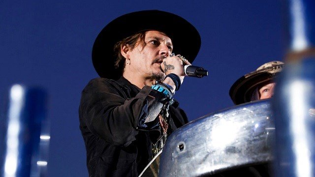 Actor Johnny Depp introduces a film at the Glastonbury music festival at Worthy Farm, in Somerset, England.