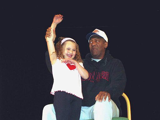 Comedian Bill Cosby, right, jokes with Bethany Robertson, 5, while talking about the importance of staying in school to a group of students from the Sisseton-Wahpeton Tribe Sunday, March 30, 2003, in Hankinson, N.D.