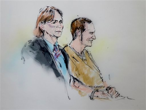 Attorney Judy Clark and defendant Jared Loughner stand before the judge in federal court Wednesday, March 9, 2011 in Tucson, Ariz. as shown in this artists' rendering.