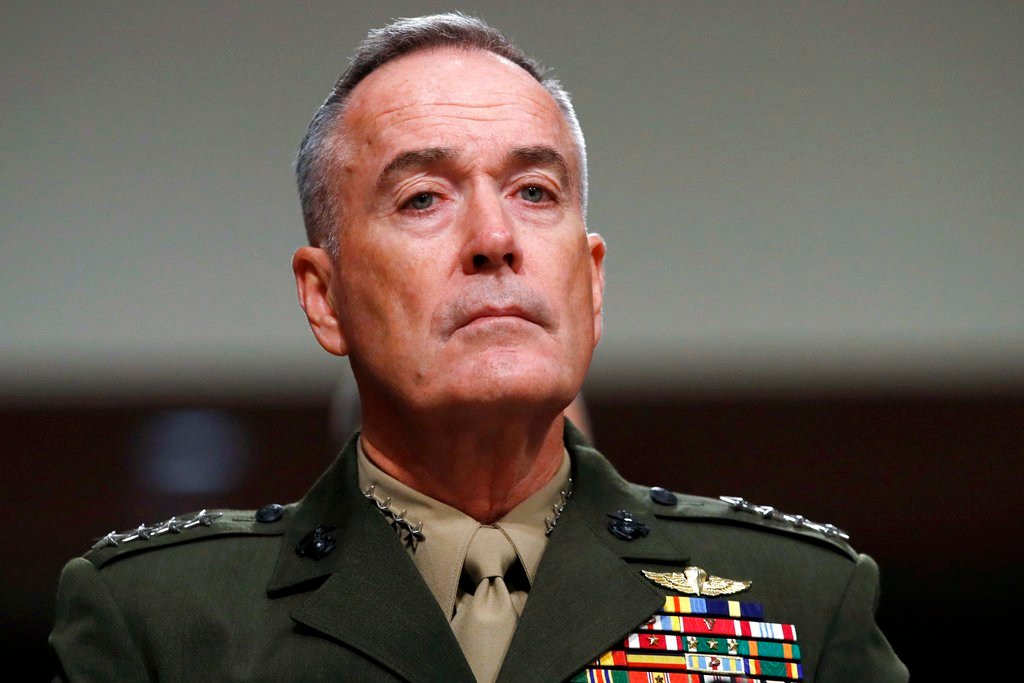 FILE - In this June 13, 2017, file photo. Joint Chiefs Chairman Gen. Joseph Dunford listens on Capitol Hill in Washington. Military chiefs will seek a six-month delay before letting transgender people enlist in their services, officials said June 23. Dunf