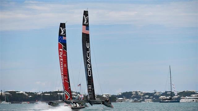 Emirates Team New Zealand competes against Oracle Team USA during the America's Cup
