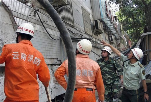Firemen search for victims after an earthquake jolted Yingjiang county in southwestern China's Yunnan province on Thursday, March 10, 2011. (AP Photo)