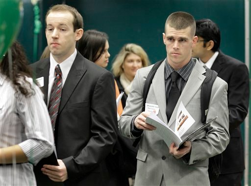 In this March 4, 2011 photo, Ryan Gratzer, right, stands in line to talk with a representative from the Cleveland Clinic at the 32nd Annual Spring Career Fair at Cleveland State University. (AP Photo/Amy Sancetta)