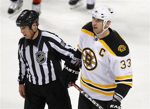 March 8, 2011, file photo: Boston Bruins' Zdeno Chara being escorted off the ice by an official after hitting Montreal Canadiens' Max Pacioretty during the second period NHL hockey game, in Montreal. (AP Photo/The Canadian Press, Paul Chiasson, File)