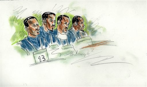 This courtroom sketch depicts the first appearance in federal court of some of the fourteen suspected pirates captured after four Americans were killed aboard a hijacked yacht in February, Thursday, March 10, 2011.