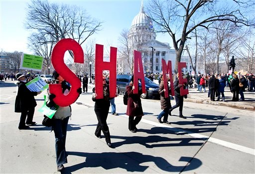 Protesters walk around the Capitol Square in Madison, Wis. Thursday March 10, 2011 as protests continued after the Senate passed governor's controversial budget repair bill, and the Assembly was meeting to consider final passage.