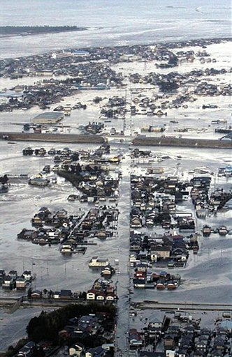 Buildings are submerged after an earthquake-triggered tsunami hit Yamamoto town in Miyagi prefecture (state), Japan.