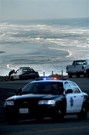 With a tsunami warning in effect for Northern California, police patrol along San Francisco's Great Highway on Friday, March 11, 2011. Tsunami warnings were issued after an 8.9-magnitude earthquake struck Japan. (AP Photo/Noah Berger)