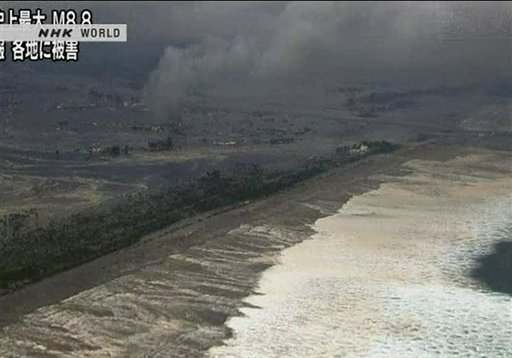 In this video image taken from Japan's NHK TV, a wave from the tsunami heads to the coast in Miyagi Prefecture on the north east coast of Japan Friday March 11, 2011 following a massive earth quake.