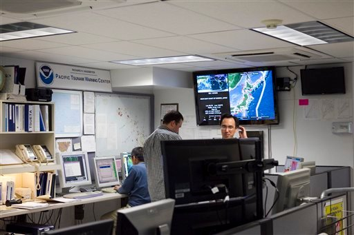 Workers are seen inside the Pacific Tsunami Warning Center, Thursday, March 10, 2011 in Honolulu.