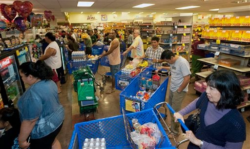 Hundreds of Oahu residents flocked to the Times Supermarket to purchase water and supplies Thursday, March 10, 2011 in Honolulu.