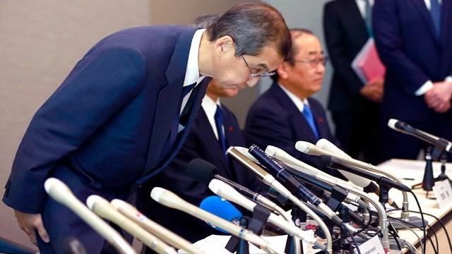 Japanese air bag maker Takata Corp. CEO Shigehisa Takada bows during a press conference in Tokyo.