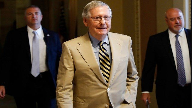 Senate Majority Leader Mitch McConnell of Ky. walks from his office on Capitol Hill in Washington.