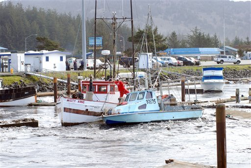 Driven by the force of a tsunami surge, a loose boat slams into another in the boat basin at Crescent City, Calif., on Friday, March 11, 2011.