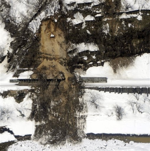 Landslide covers train tracks near Echigotanaka Station in Niigata prefecture (states), Japan, Saturday, March 12, 2011. (AP Photo/Kyodo News)