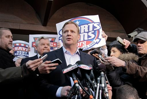 NFL Commissioner Roger Goodell, center, speaks with reporters as negotiations between the NFL owners and players go unresolved, at the Federal Mediation and Conciliation Service in Washington, Friday, March 11, 2011.
