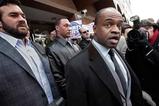 DeMaurice Smith, right, executive director for the NFL Players Association, speaks with reporters as negotiations between the NFL owners and players go unresolved, at the Federal Mediation and Conciliation Service in Washington.