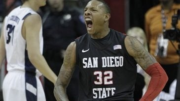 San Diego State's Billy White reacts after scoring against BYU during the first half of an NCAA college basketball game in the championship game of the Mountain West Conference tournament, Saturday, March 12, 2011, in Las Vegas. (AP Photo/Julie Jacobson)