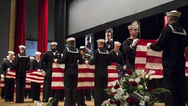 U.S. Navy, sailors fold seven U.S. flags during a memorial ceremony at Fleet Activities (FLEACT) Yokosuka, south of Tokyo.
