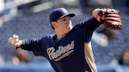 San Diego Padres pitcher Tim Stauffer throws during the first inning of a spring training baseball game against the Seattle Mariners Sunday, Feb. 27, 2011 in Peoria, Ariz. (AP Photo/Charlie Riedel)