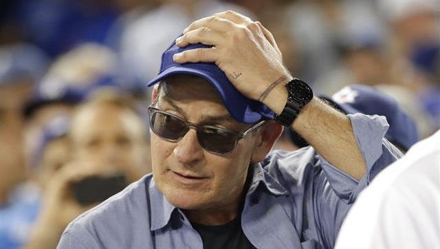 Actor Charlie Sheen reacts during the fifth inning of Game 4 of the National League baseball championship series.