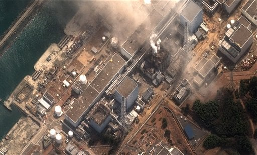 This satellite image provided by DigitalGlobe shows the damaged Fukushima Dai-ichi nuclear facility in Japan on Monday, March 14, 2011.