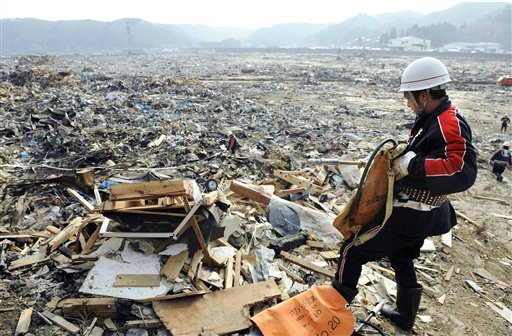 A rescuer searches for the victims of Friday's tsunami in Miyako, Iwate Prefecture, northern Japan, Monday, March 14, 2011, three days after a massive earthquake and the ensuing tsunami hit the country'seast coast.
