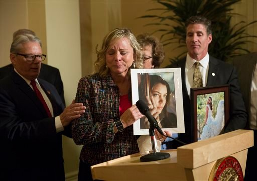 FILE - In this Sept. 11, 2015 file photo, Debbie Ziegler, mother of Brittany Maynard, speaks to the media after the passage of legislation, which would allow terminally ill patients to legally end their lives, at the state Capitol in Sacramento, Calif. (A