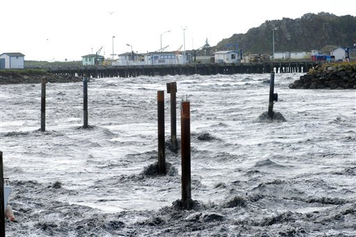 This March 11, 2011 file photo shows the tsunami surge roaring like a river into the boat basin at Crescent City, Calif. Experts say Crescent City is a tsunami magnet due to the formation of the sea floor and the small boat basin. (AP Photo/Jeff Barnard)