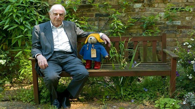 British author Michael Bond sits with a Paddington Bear toy during an interview with The Associated Press in London.