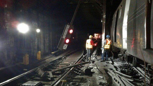 Transport Workers Union, Local 100, workers from the New York Metropolitan Transportation Authority respond to the scene of a subway derailment.