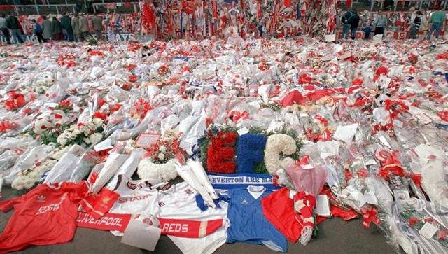 Floral tributes are placed by soccer fans at the 'Kop' end of Anfield Stadium in Liverpool, England.