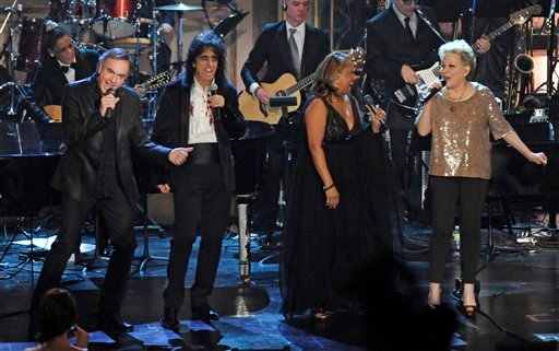 Left to right, Neil Diamond, Alice Cooper, Darlene Love, and Bette Midler perform at the Rock and Roll Hall of Fame induction ceremony, Tuesday, March 15, 2011, in New York. (AP Photo/Evan Agostini)