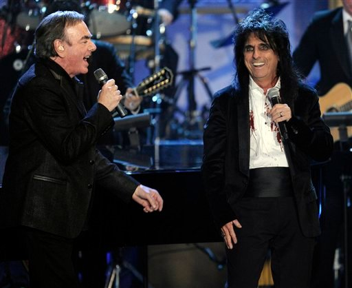 Inductees Neil Diamond, left, and Alice Cooper perform at the Rock and Roll Hall of Fame induction ceremony, Tuesday, March 15, 2011 in New York. (AP Photo/Evan Agostini)