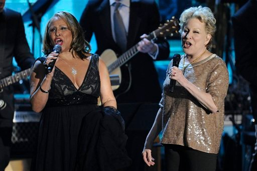 Inductee Darlene Love, left, performs with Bette Midler at the Rock and Roll Hall of Fame induction ceremony, Monday, March 14, 2011, in New York. (AP Photo/Evan Agostini)