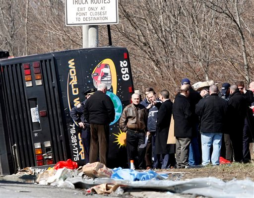 New York Police Commissioner Raymond Kelly speaks with emergency personnel investigating the scene of a bus crash on Interstate-95 in the Bronx borough of New York Saturday, March 12, 2011. (AP Photo/David Karp)
