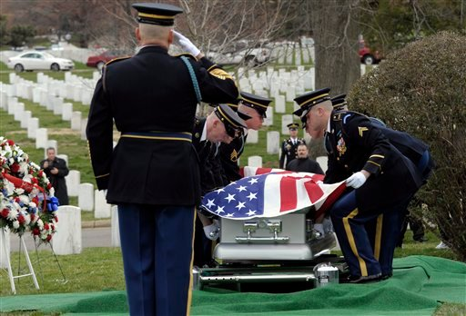 The casket of Army Cpl. Frank Buckles, the last American veteran of World War I, is placed for the graveside funeral service at Arlington National Cemetery in Arlington, Va., Tuesday, March 15, 2011.