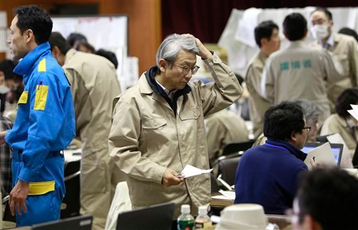 Teams of government specialists at the emergency rescue headquarters frantically analyze data from the leaked radiation from the Fukushima nuclear facilities damaged by last week's major earthquake. (AP Photo/Wally Santana)