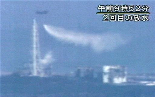 Caption  In this photo made off NHK TV video footage, a Japan Self-Defense Force helicopter dumps water over the No. 3 unit of the Fukushima Dai-ichi nuclear power plant in Okumamachi, Fukushima Prefecture, Thursday, March 17, 2011.