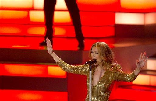 Celine Dion sings her last number during her opening night performance at Caesar's Palace, Tuesday, March 15, 2011, in Las Vegas. (AP Photo/Julie Jacobson)