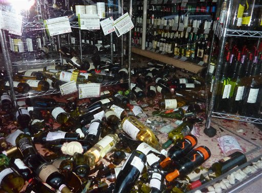 Broken bottles litter on the floor of a food shop in Sendai after a powerful earthquake hit northern Japan on March 11, 2011. (AP Photo/Kyodo News)